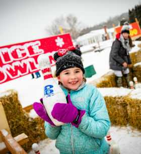 Girl Holding Ice Bowling Pin at Fish Creek Winter Festival 01