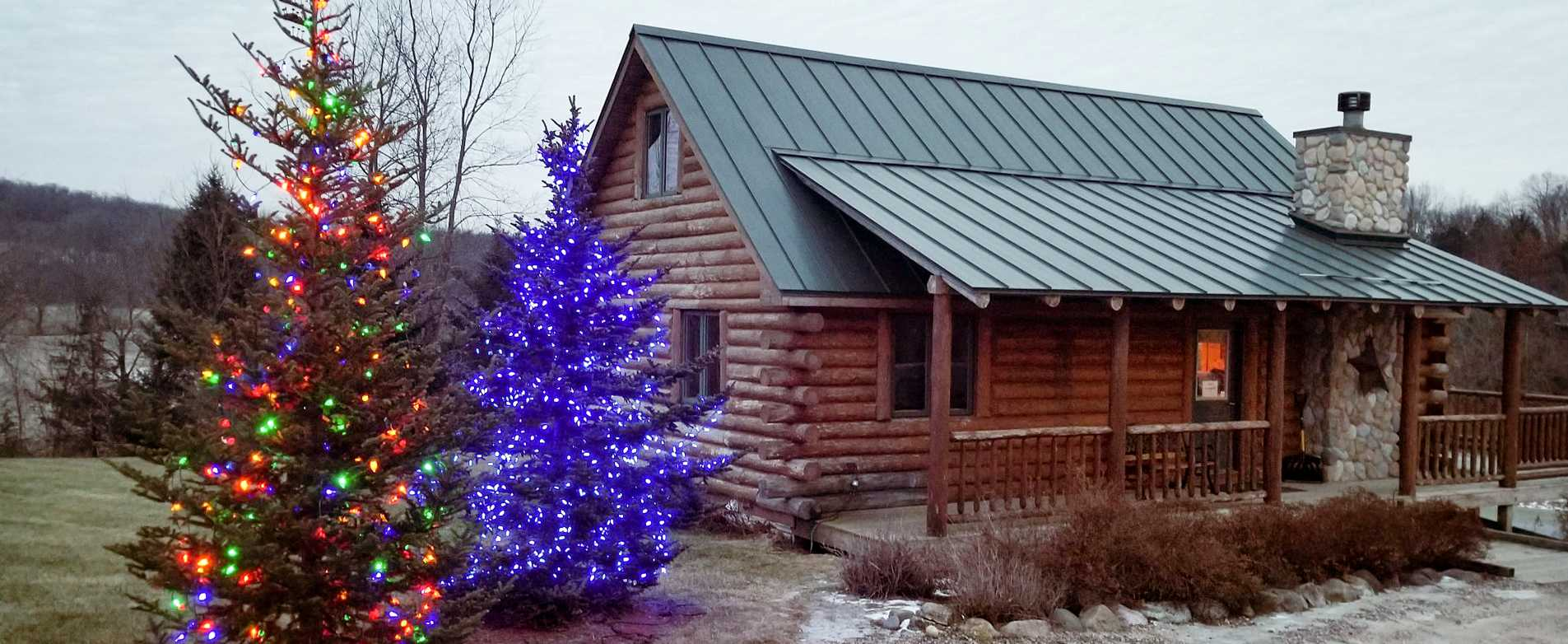 Cabin at Rustic Ridge Resort with Holiday Lights Up