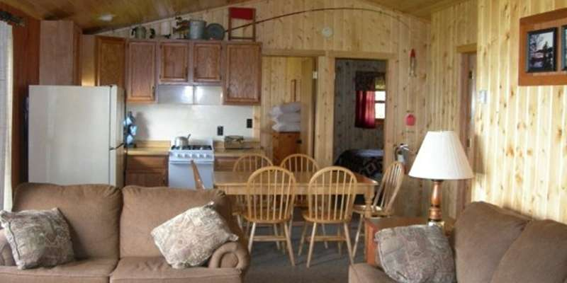 Our cabins have all the amenities of home with fully equiped kitchens, DirecTV, fireplaces in some units, charcoal grill, picnic tables and ample storage for all of your equipment.