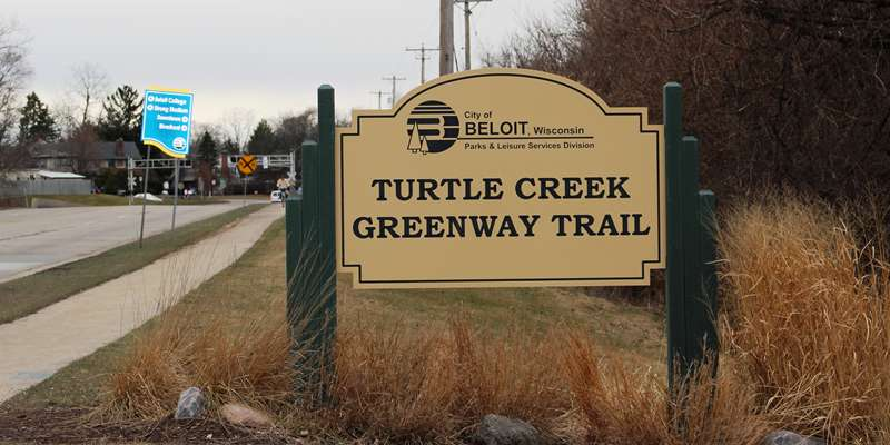The Turtle Creek trail sign by the parking lot entrance on Milwaukee Road