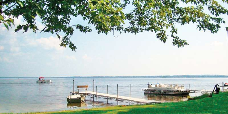 Breathtaking view from our 110' of Shawano Lake west shore frontage.