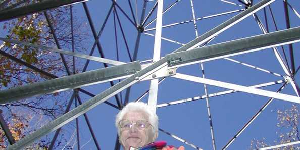 Betty stands by the fire tower that she worked for several seasons in the 1940s. Check out the site's interpretive signs to learn her story.