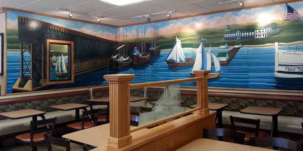 The walls of McDonald's in Ashland are adorned with vibrant murals depicting the city's historic waterfront on Chequamegon Bay.