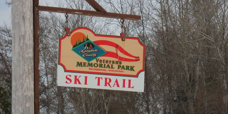 The sign from the road heading into Jack Lake Ski Trail, which is also known as Veteran's Memorial Park.