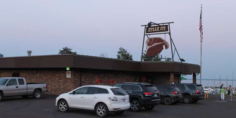 Located near the marina in Washburn, The Steak Pit has plenty of easy parking and an outdoor patio.