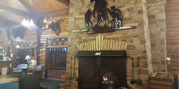 Massisve stone fireplace in common gathering space of the historic Lodge that we are located within