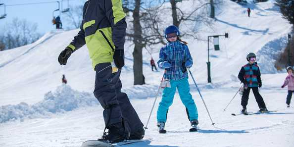 Learn to ski with us! Skiing and snowboarding fun all winter long at The Mountain Top.