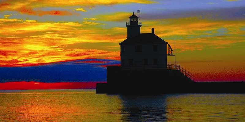Vivid colors behind the Superior Entry Lighthouse. Photo by Tom Mackay.
