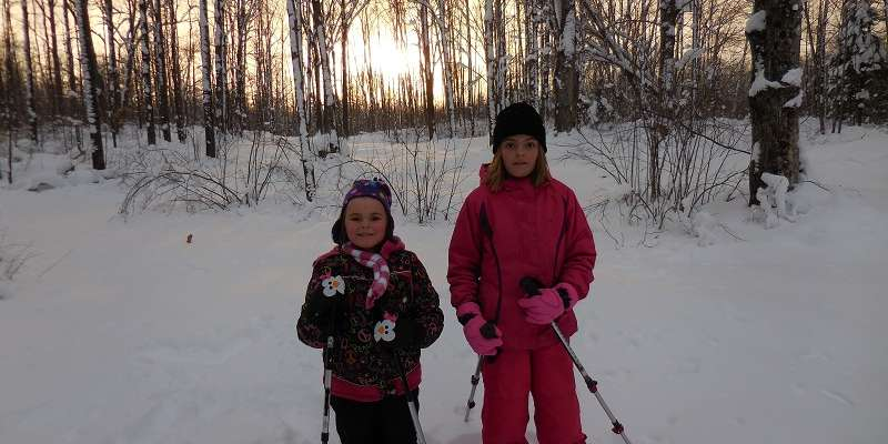 Kids Snowshoeing Until Sunset at Jack Lake Snowshoe Trails.
