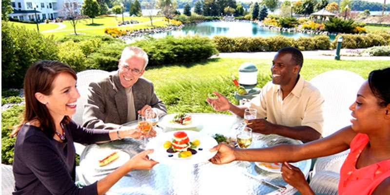 Dine alfresco with a beautiful view of the grounds, pond and lake.