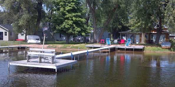 Relax and enjoy this waterfront vacation home on Shawano Lake's west shore.