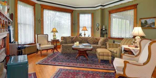 Relax in the Common Room at the Fargo Mansion Inn.