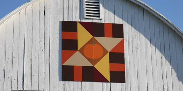 See two Barn Quilts located on our farm.