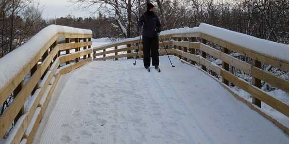 Cross Country Skiing down one of the Springbrook Trail bridges in the City of Antigo