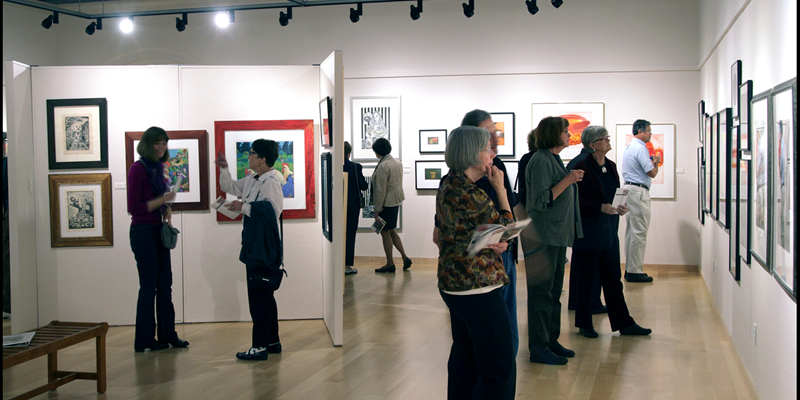 Opening night reception of a new gallery exhibit.