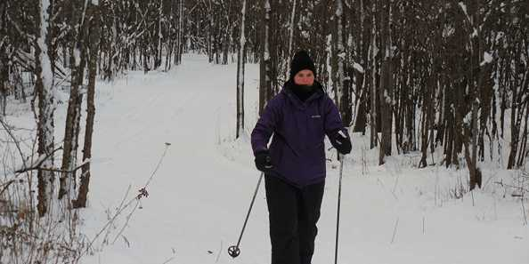 Cross Country Skiing through the woods on one of the Springbrook Trails in the City of Antigo
