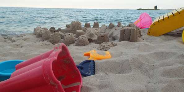 Build a sandcastle while playing on our beautiful sand beach that is over 160' long.