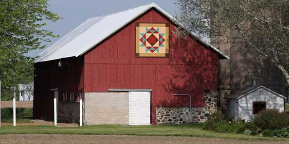 "Quilt #131, ""Crown of Thorns"" is sponsored and hosted by Dean & Vicki Dallmann, W8745 Evergreen Road, Shawano, WI. Their barn was built in 1890."
