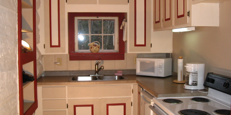 The beautiful kitchen has full amenities.