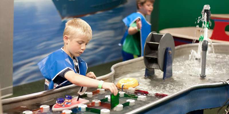 Children of all ages love to play in the Waterways Room.