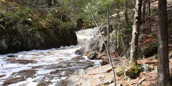 Smalley Falls in Marinette County Forest - To reach Smalley Falls, head north on Hwy. 141 to Morgan Park Road and watch for a sign indicating the turnoff tot he falls. The turnoff goes to a small grassy parking area where a walking trail leads to the falls. Steep slopes offer a beautiful view of the falls. The turnoff leading to the parking area can be rough.