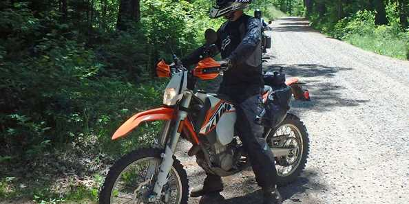 A dual sport rider enjoying the backroads and forest paths in the Boulder Junction area.