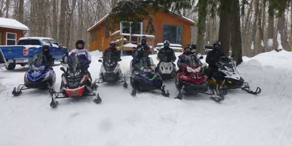 Group of snowmobilers ready to hit the trails. We've got over 1200 miles of trails to explore in the Cable Area!