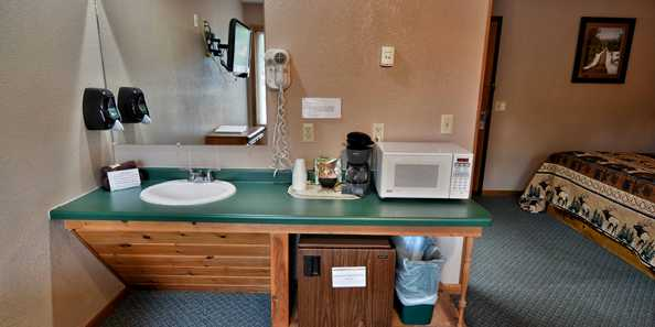Comfortable, clean motel rooms with air conditioning, wireless internet, clock radio, microwave, refrigerator, Cable TV, 32″ flat screen TV, and hair dryer.