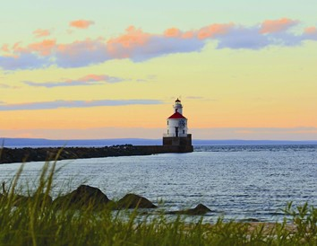 Superior Entry Lighthouse on Wisconsin Point at sunset. Photo by Megan Wilson.