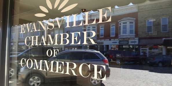 Historic Main Street is reflected in the window of the Evansville Area Chamber of Commerce & Tourism.