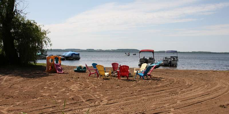 Enjoy 75 feet of private beachfront on Shawano Lake.