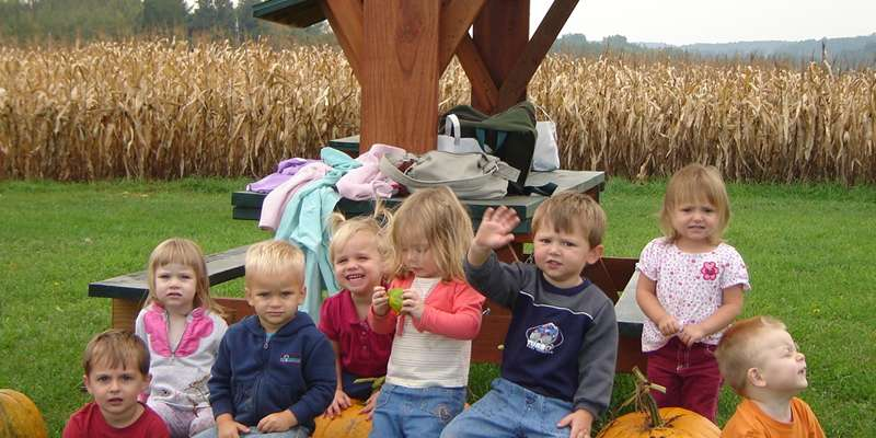 Fall fun with kids picking pumpkins and a corn maze.