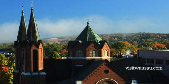 Morning fog lifts over Wausau.